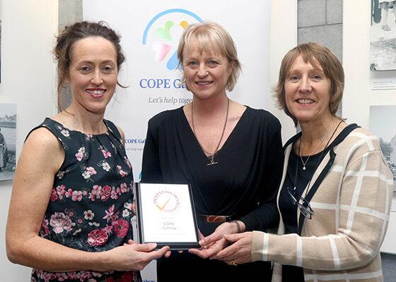 COPE Galway receiving Investing in Volunteers award