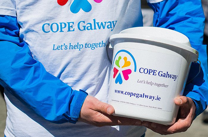 fundraiser holding cope galway donation bucket